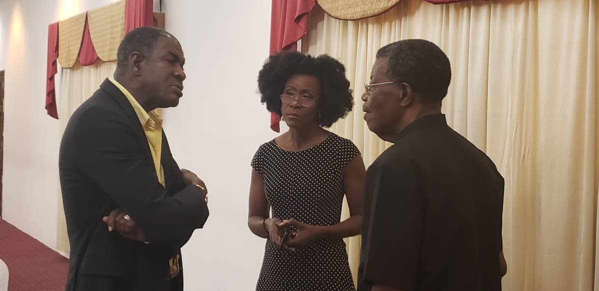 Political leader of the Tobago Organisation of the People Ashworth Jack, left, chats with Tobago Forwards leader Christlyn Moore, centre,  and Platform of the Truth's leader Hochoy Charles at a recent press conference.