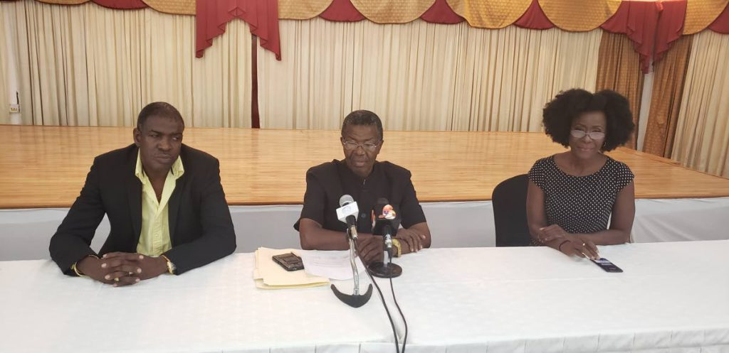 Political Leader of the Tobago Organisation of the People  Ashworth Jack, left, Platform of Truth leader Hochoy Charles, centre, and Tobago Forwards leader Christlyn Moore address members of the media during a press conference at the Rovannel's Conference Centre.