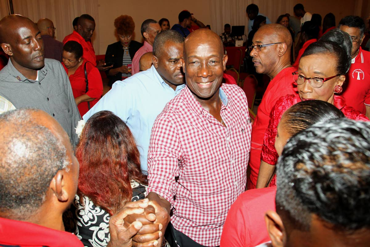 In this May 8, 2019 file photo, Dr Keith Rowley greets members of the audience gathered for a political meeting hosted by the ruling People's National Movement at Signature Hall, Chaguanas.