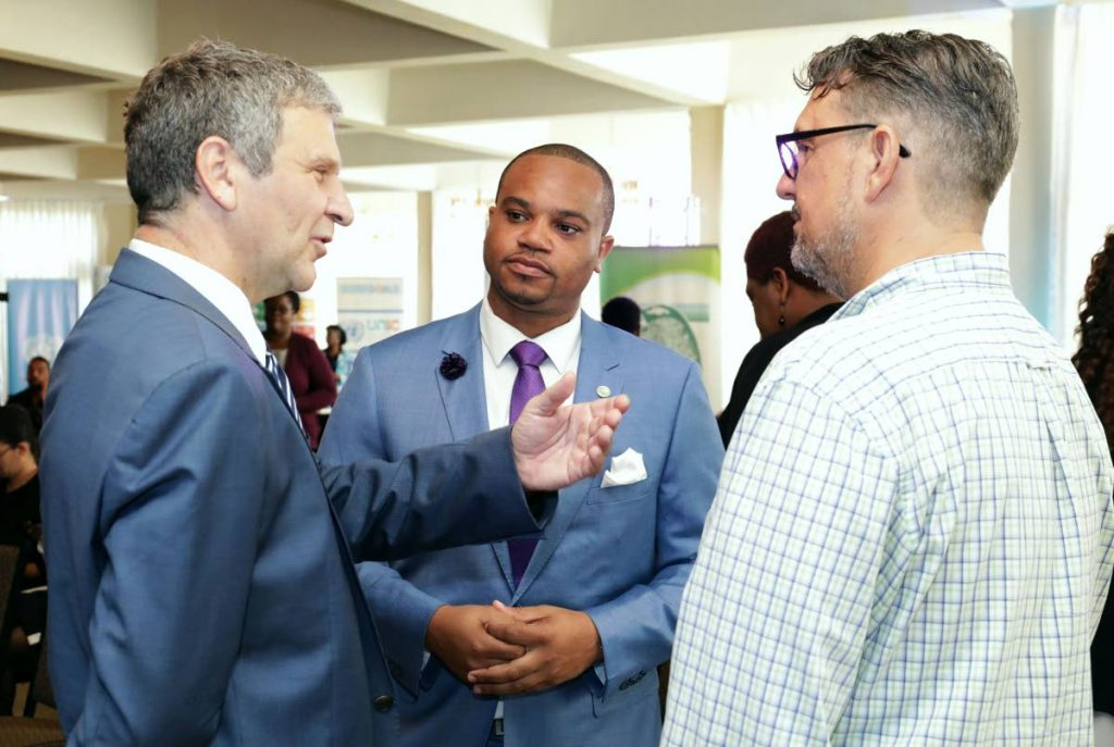Deputy Head of Mission of the German Embassy Andreas Haack, left, chats with Environment Secretary, Kwesi Des Vignes, centre, and CEO of the Environmental Research Institute of Charlotteville, Aljoscha Wothke.