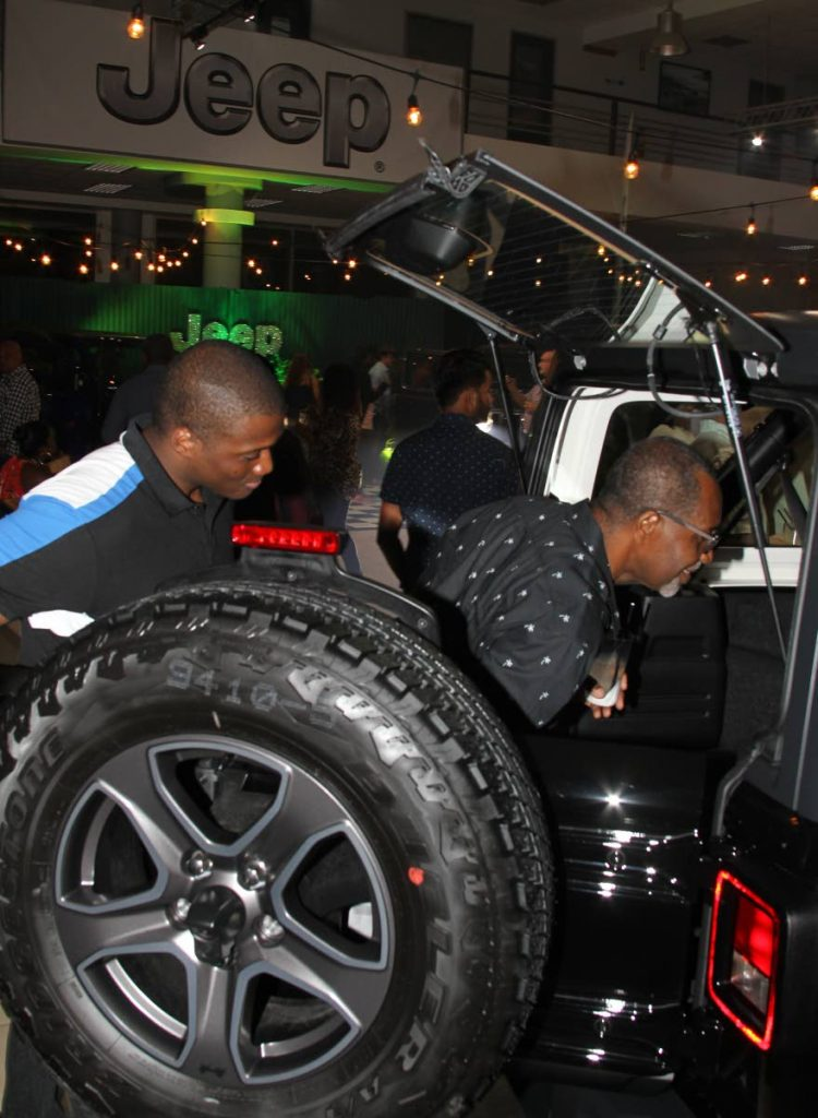 Guests Noland Murray and Carl Plante take a look at the Jeep Wrangler's cargo space, during the official launch of the 2019 model, hosted by Lifestyle Motors on May 18, 2019. PHOTOS BY ROGER JACOB