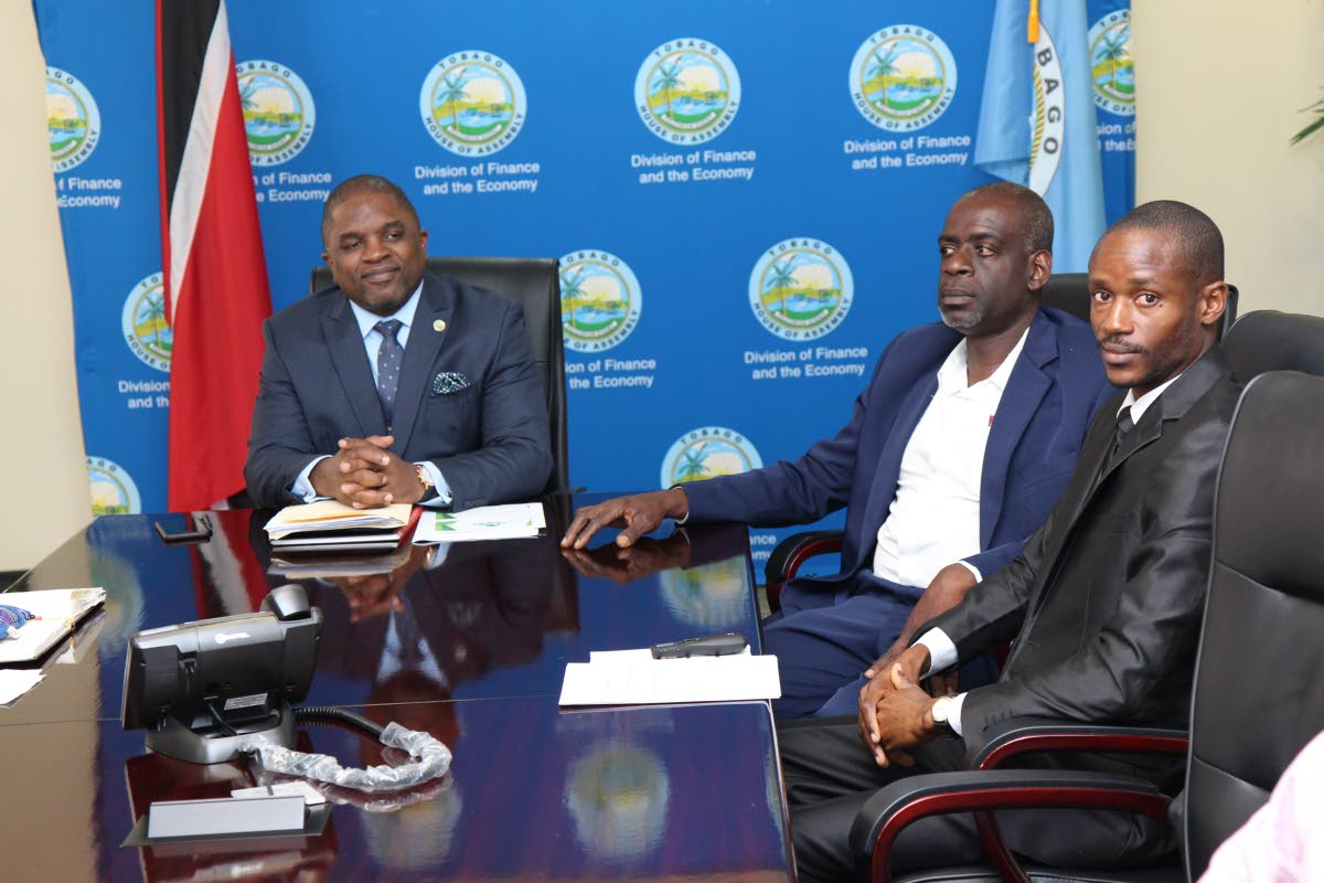 Secretary of the Division of Finance and the Economy Joel Jack, left, at a recent budget consultation meeting with Tobago Agricultural Society head Dedan Daniel and treasurer of the Bee-Keepers Association James Keron at the Victor E Bruce Complex, Scarborough.