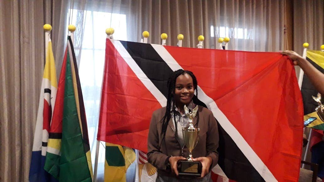 Khalifa Baisden poses with her second place trophy she won at the Toastmasters Regional Competition in Bon Air.