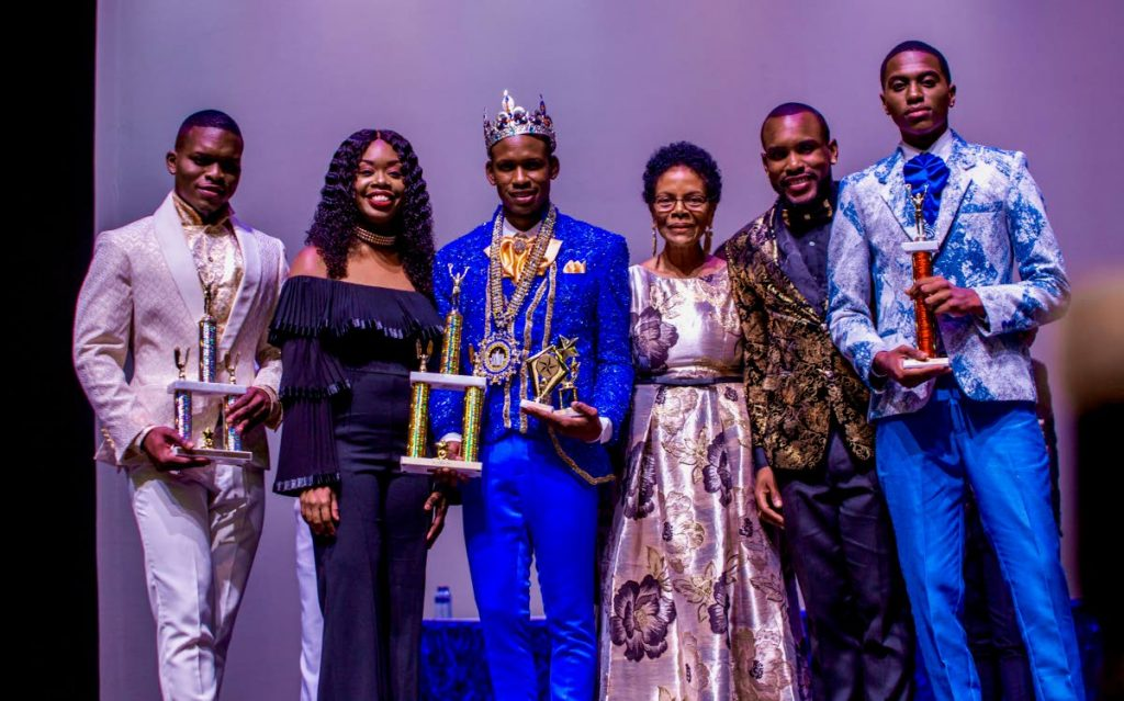 Mr Caribbean 2019 winner Yohance Smith of BVI, centre, with his crown alongside runner-up Johnathan Samuel of Trinidad, left, third place Kofi Gilkes of Barbados, right, and Dominica's contestant Jorvan Kerwin JnoBaptiste, second from right. Also presentwere Tourism Secretary Nadine Stewart-Phillips, second from left, and Mr Caribbean chairman Marie Antoinette Mora, third from right, at Shaw Park last Saturday.