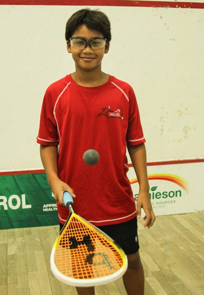 Going for victory: Junior squash champion Seth Thong – during practice at the Queen's Park Squash Courts, St Clair – is a favourite to win the Caribbean championship in Trinidad in July.