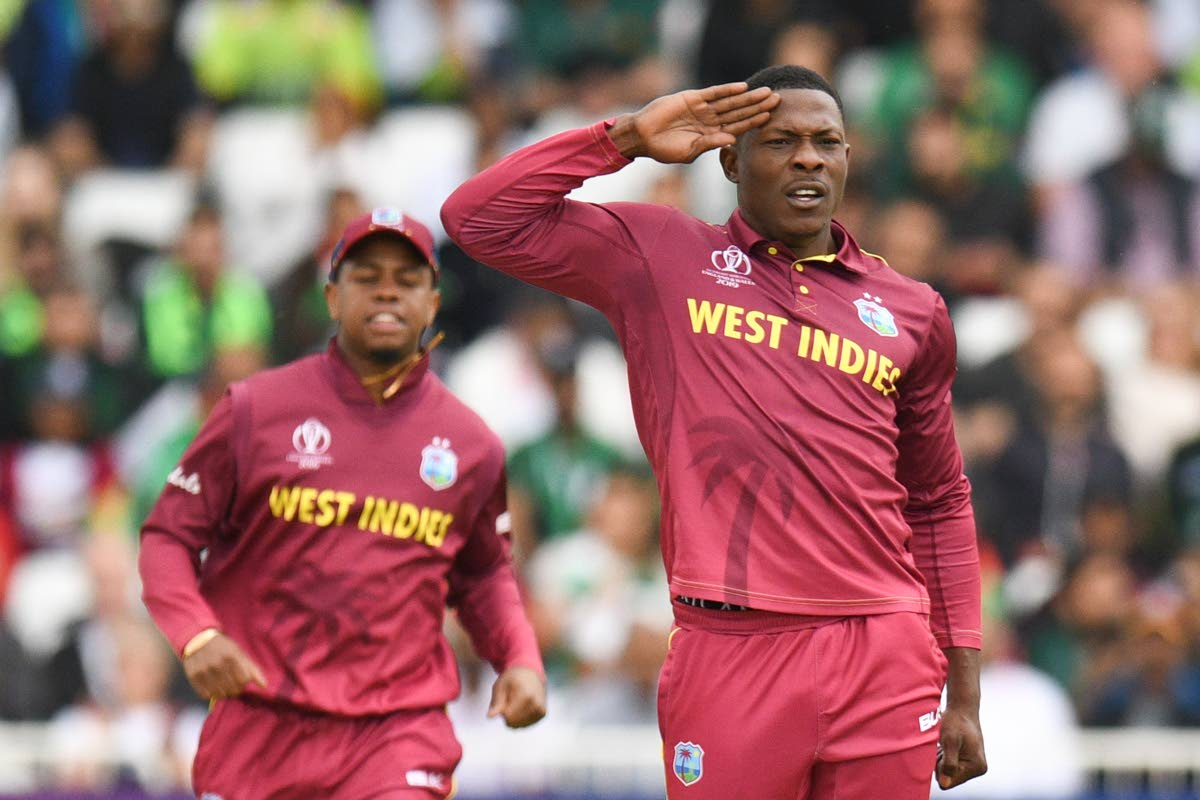 Sheldon Cottrell, right, celebrates during a previous match.