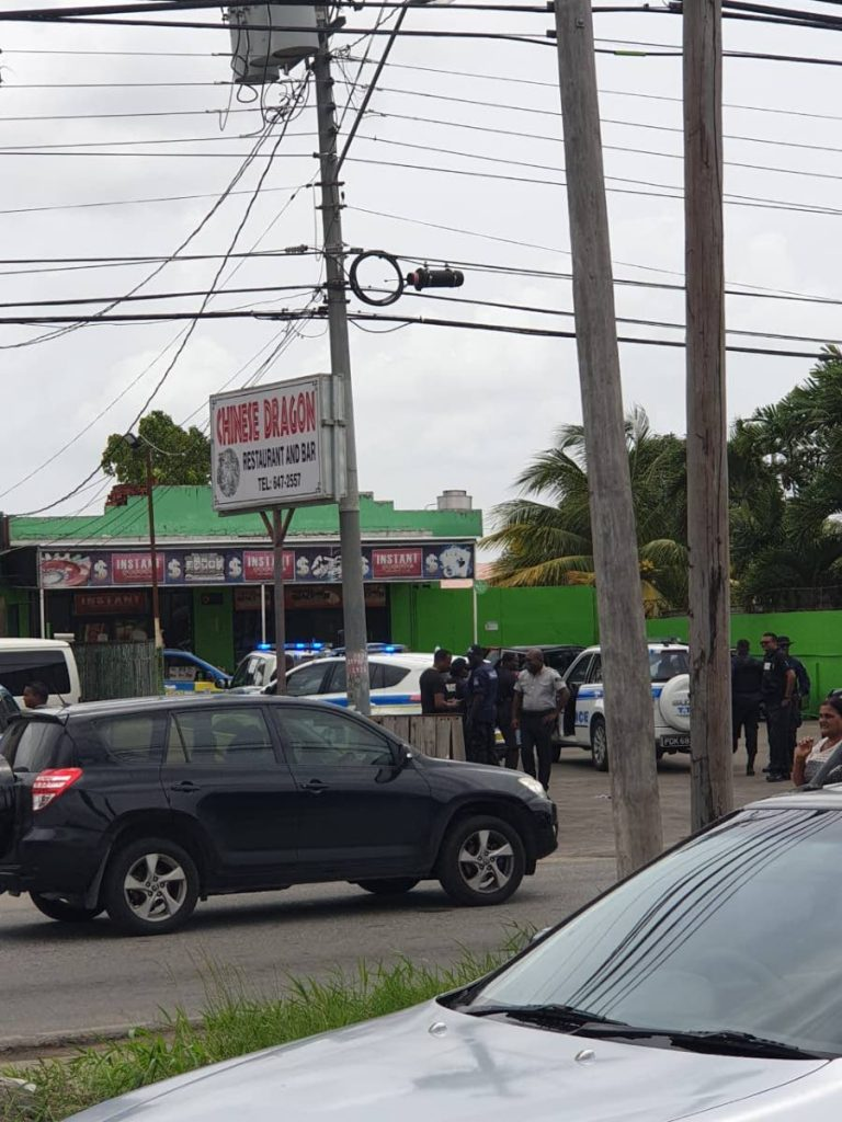 Police at Chinese Dragon Restaurant after rescuing four people and arresting two suspects in a robbery on Saturday morning. PHOTO: FACEBOOK