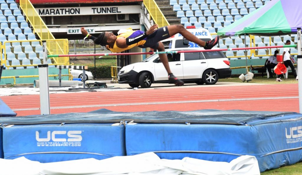 Jahmel Smith from Kaizen Panthers takes part in the long jump during the NGC/NAAA National Junior Championships, at the Hasely Crawford Stadium, yesterday.