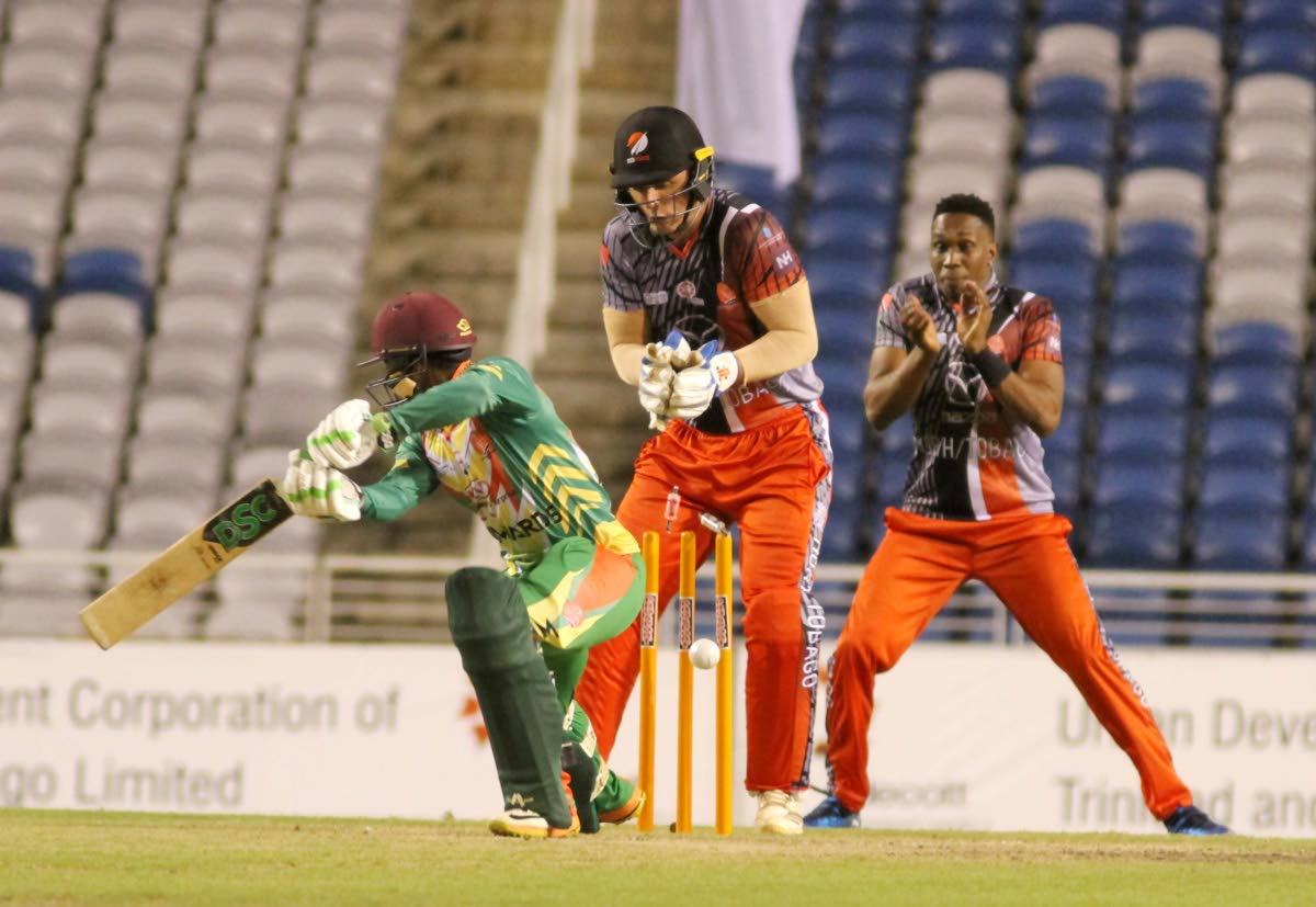 K Hodge of the Winward Islands is bowled by A Hosein (not in picture) at the Brian Lara Stadium in the match against the Tobago Team, on Friday night.