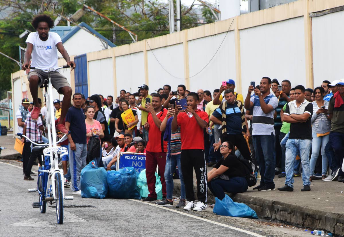 """Jahzeel Joseph pedals past Venezuelans on his """"high-rider"""" bike at the Queen's Park Oval in Port of Spain on Sunday."""