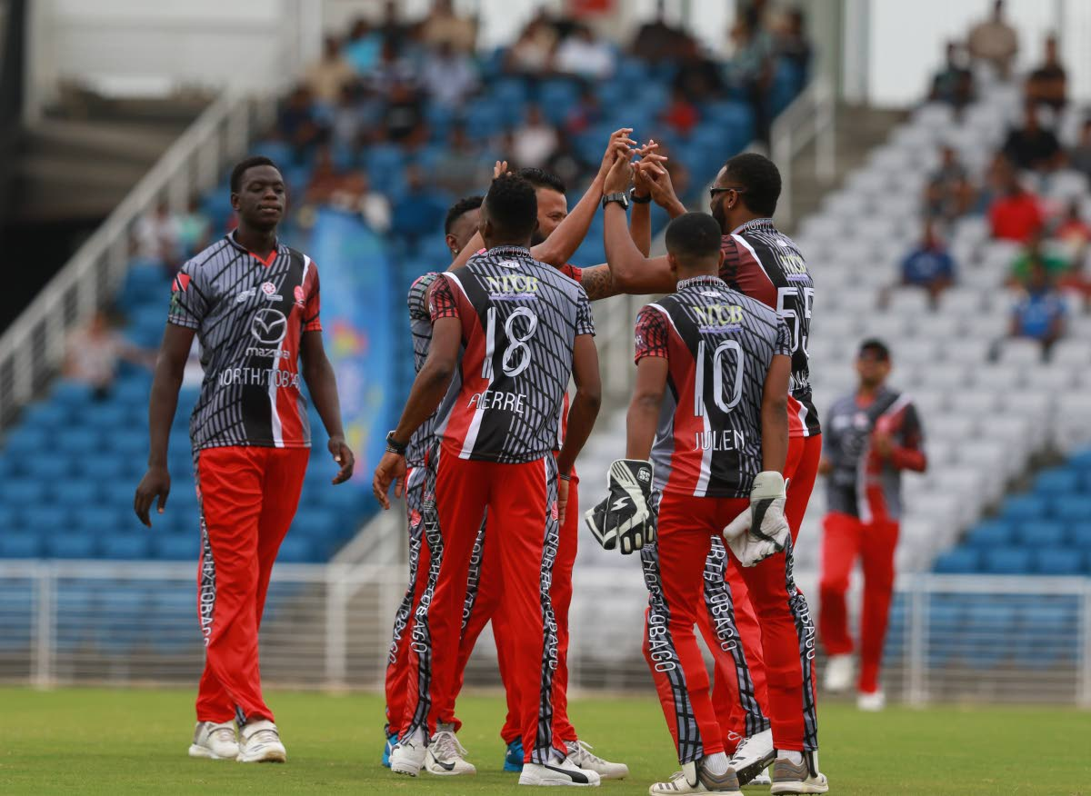 Members of the North/Tobago team celebrate a wicket during the Udecott T10 tournament against the Guyana Jaguars, on Saturday, at the Brian Lara Cricket Academy,Tarouba.