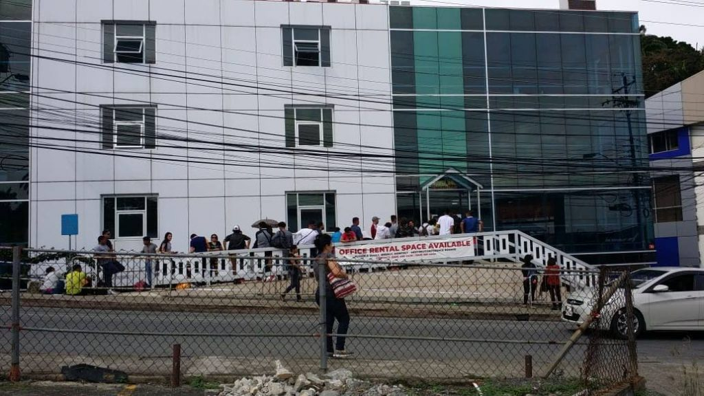 Venezuelans line-up at Caroline building in Scarborough on Sunday to get registered before Friday's deadline.