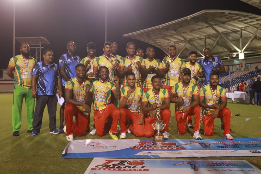 Members of the Guyana Jaguars celebrate winning the Udecott T10 tournament  final against the North/Tobago team, at the Brian Lara Cricket Academy, Tarouba, on Sunday.