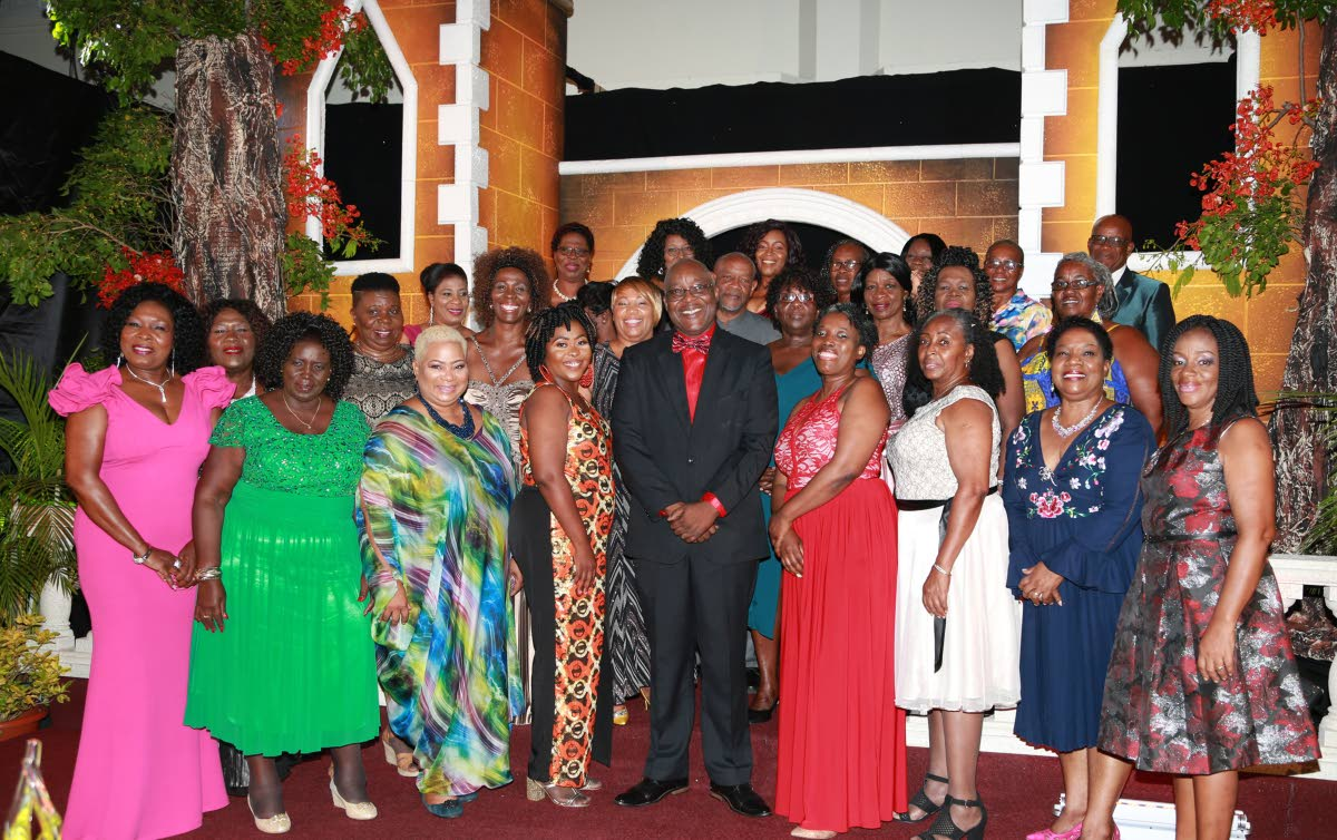 Retired teachers with THA Chief Secretary and Secretary of Education Kelvin Charles, centre, following Thursday's 12th Teachers' Retirement and Appreciation Ceremony at the Magdalena Grand Beach and Golf Resort, Lowlands