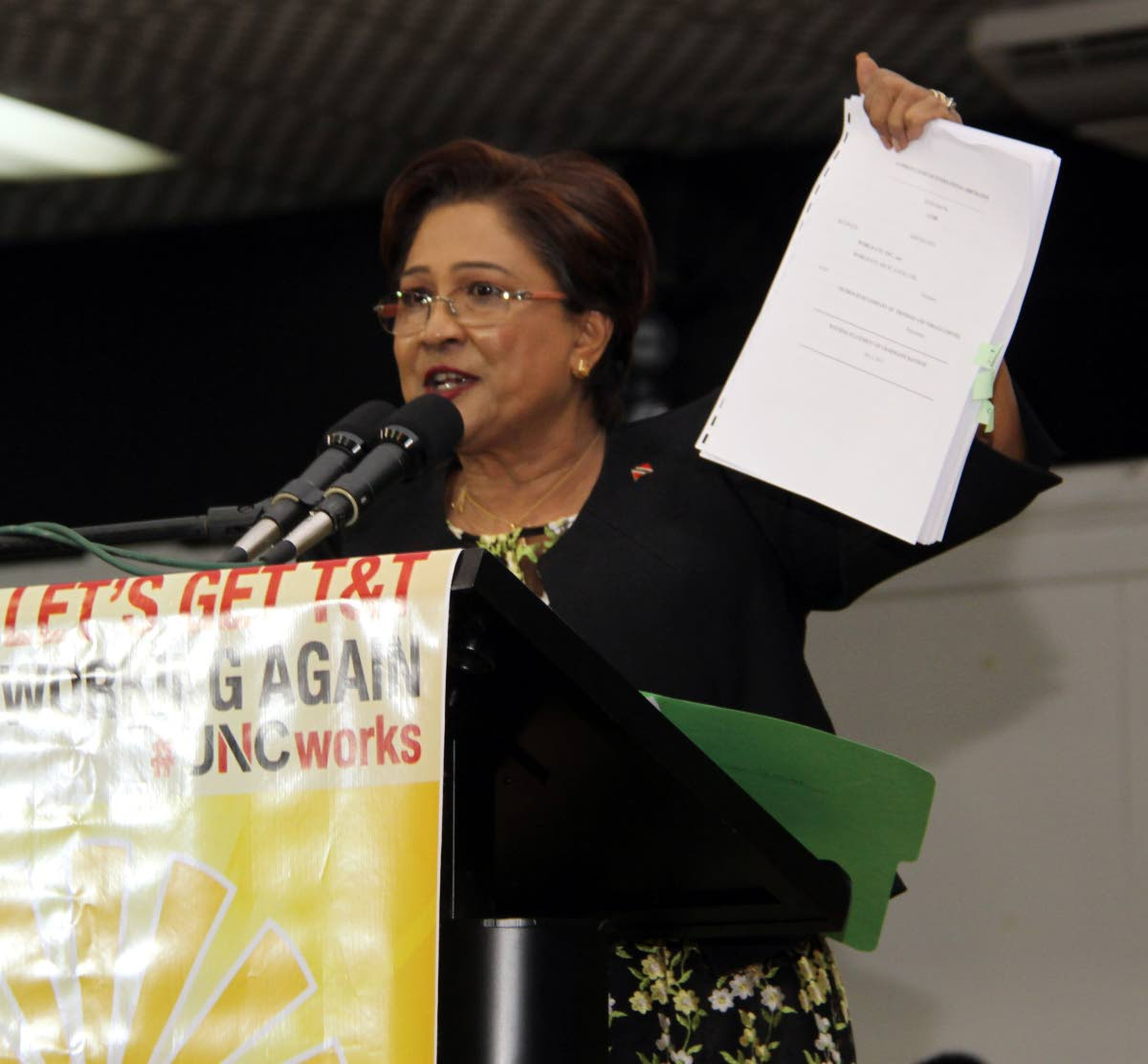 Opposition Leader Kamla Persad-Bissessar addresses supporters at the UNC's Monday Night Forum at Naparima College.