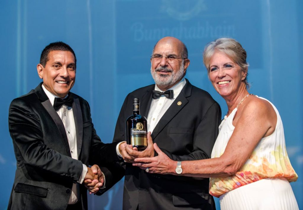 Angostura Holdings chairman Terrance Bharath presents the Bunnahabhain 39-year-old single malt to Labib Najjar managing director Metal X Engineering Ltd.