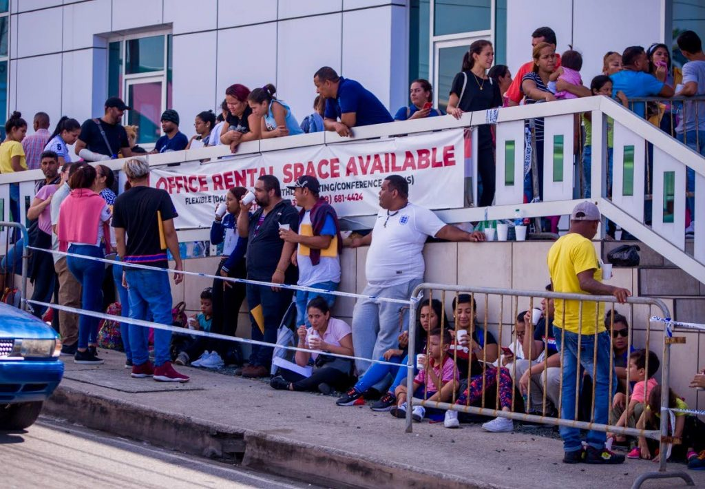 File photo: Venezuelans wait to register at Caroline Building in Scarborough on Tuesday. Hundreds of Venezuelans have been coming to Tobago to escape the long lines and chaos in Trinidad.