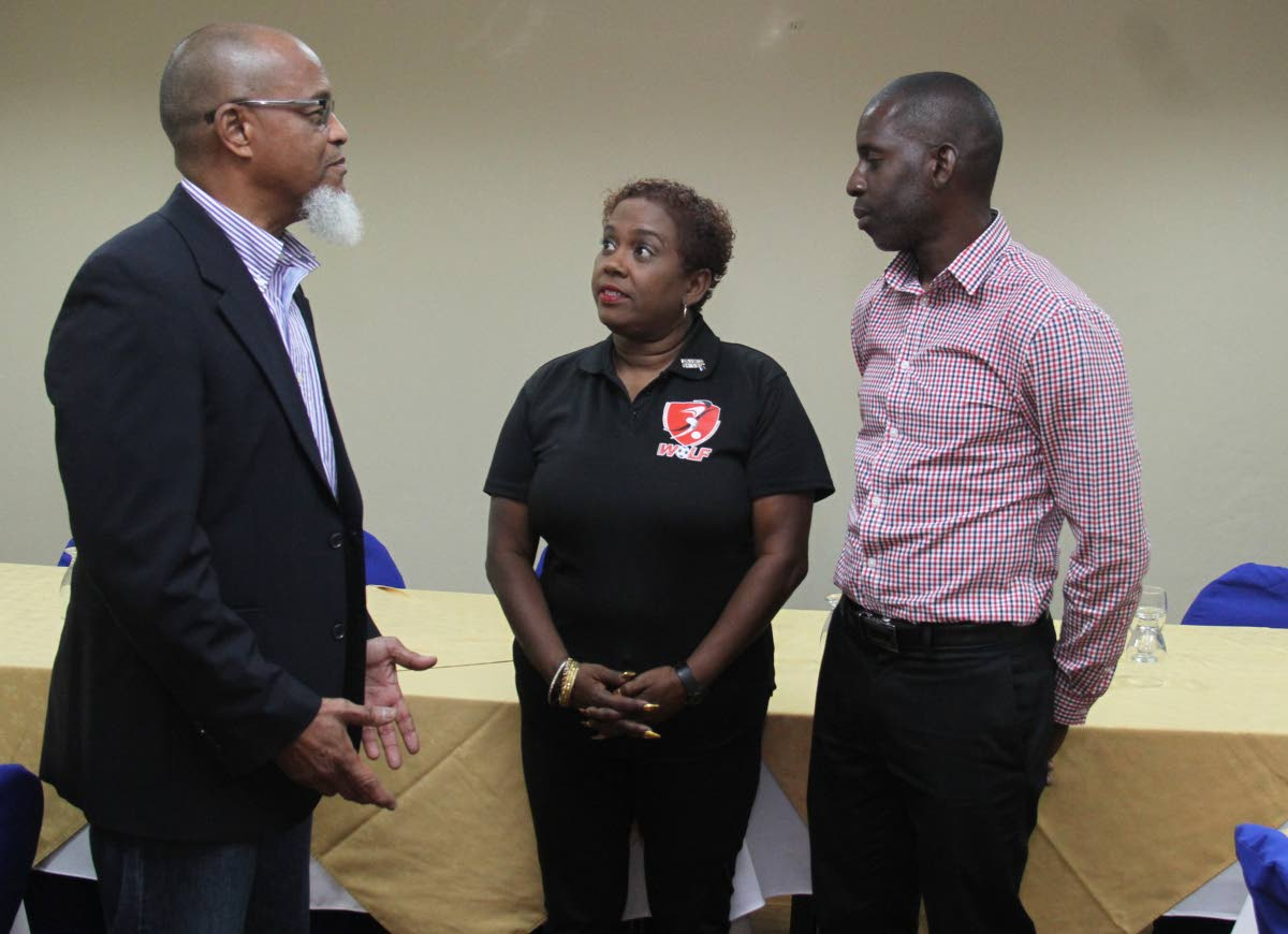President of the TT Super League and board member of the TT Football Association (TTFA)  Keith Look Loy, left, chats with president of the TT Women's League Football (WoLF) Susan Joseph-Warrick and board member of the Northern Football Association secretary Rayshawn Mars,right, at a press conference , held at the Normandie Hotel, yesterday.