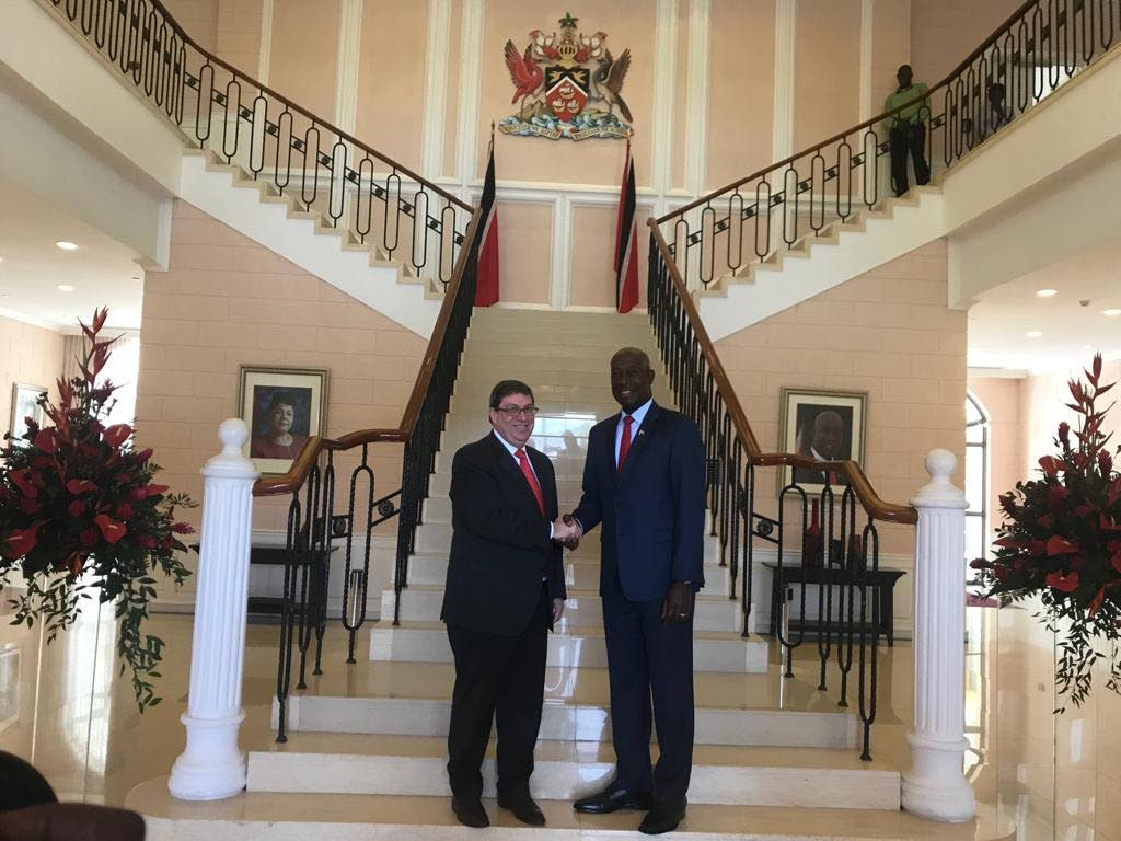 Prime Minister Dr Keith Rowley (right), greets Cuban Foreign Affairs Minister Bruno Rodrigues Parrilla at the Diplomatic Centre. Parrilla paid a courtesy call to the Prime Minister as part of his visit to TT and other Caribbean islands. PHOTO Courtesy Bruno Rodriguez Parrilla on Twitter