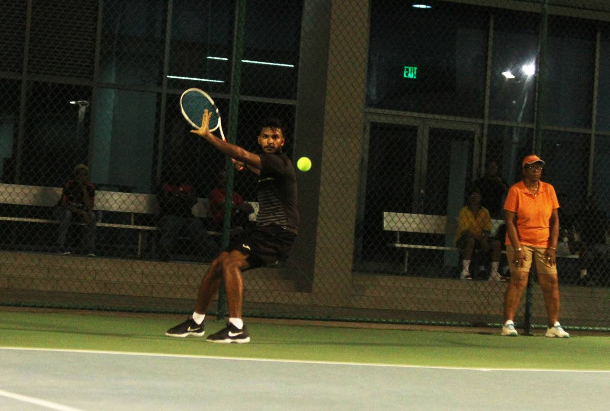 Nabeel Mohammed looks to play a shot against Richard Chung during their men's singles semi final match, at the National Tennis Championships, held at the National Racquet Centre, Tacarigua, yesterday.