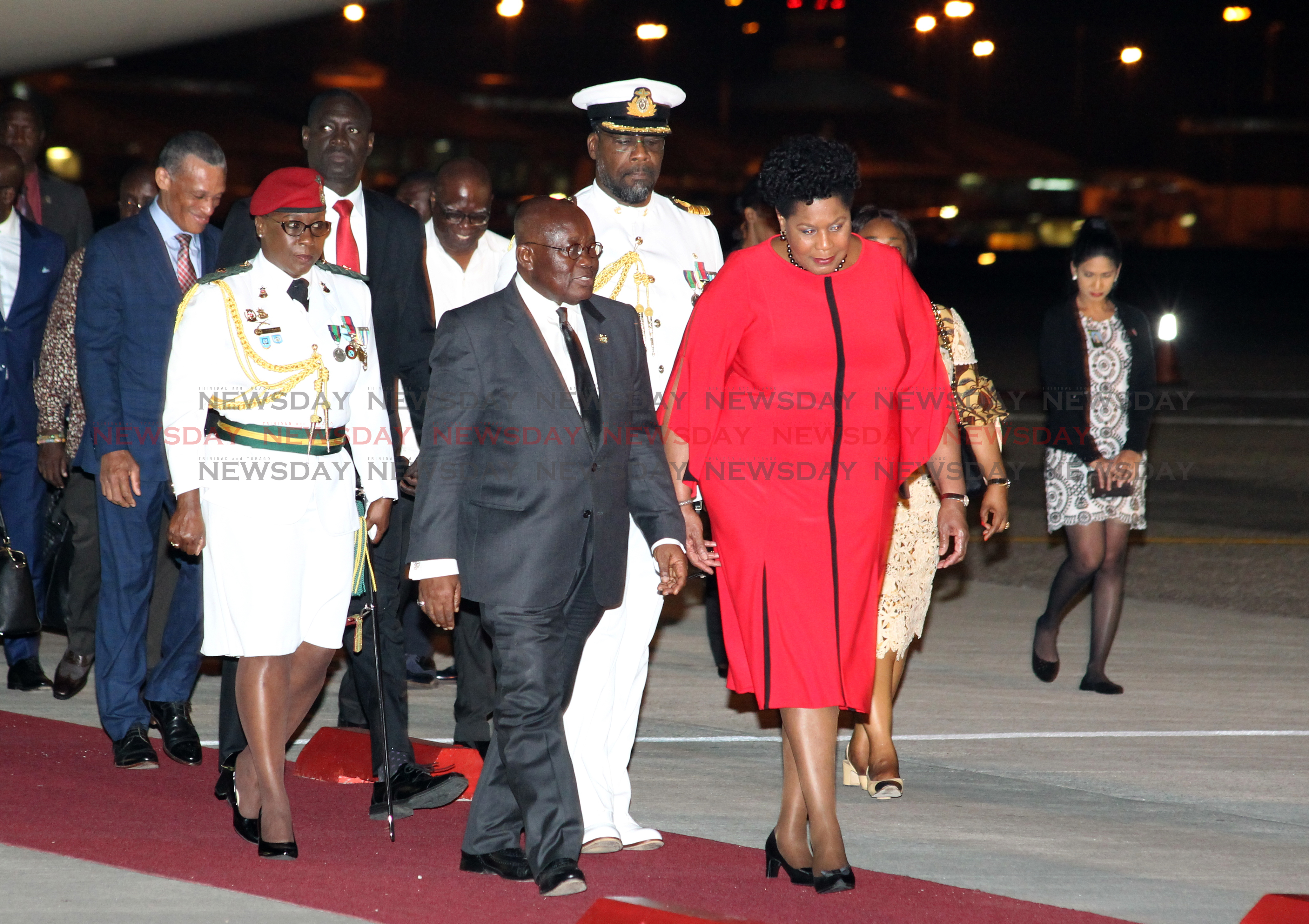 Her Excellency, Madame Justice Paula-Mae Weekes, greets his excellency Nana Akufi-Addo, President of Ghana, on his arrival to TT at the start of his official state visit.  Photo: Roger Jacob