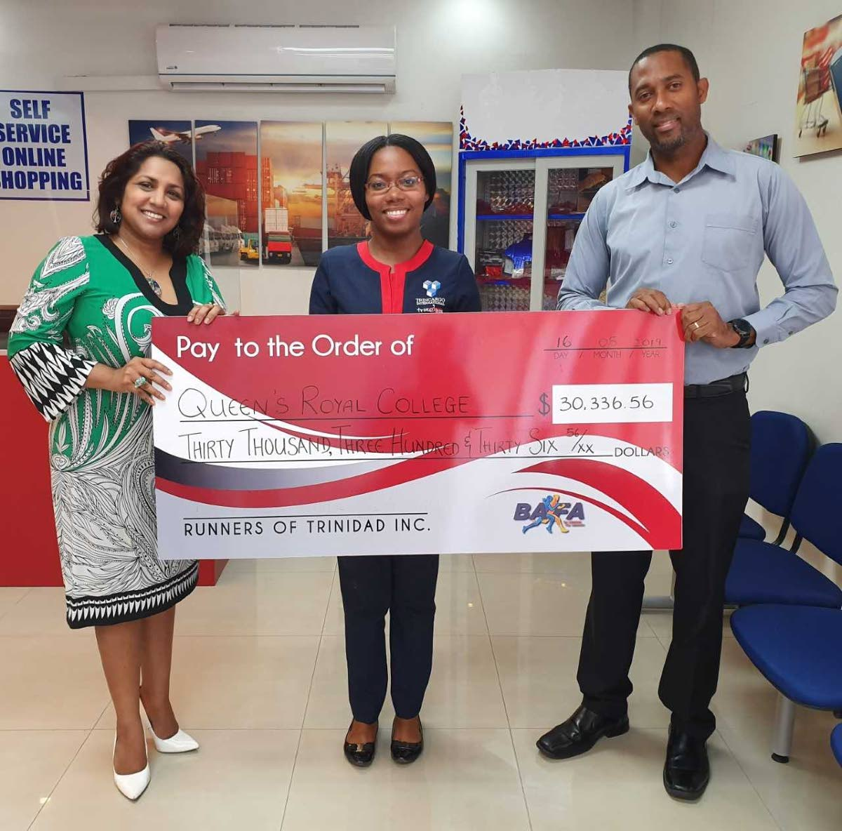 Doctor Safeeya Mohammed of Sisu Global Wellness, left, Victoria Sealey of Trinebox, middle, and Nigel Bellamy of Bafasports with the cheque that was presented to QRC.