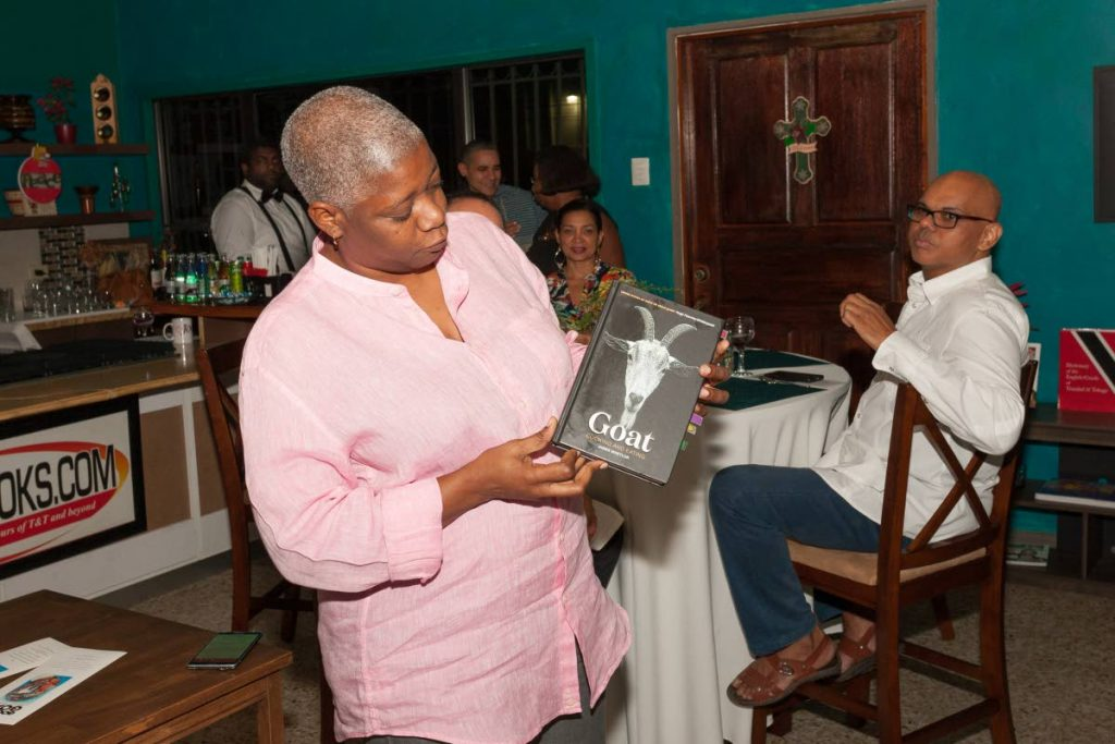Franka Philip shows off James Whetlor's book Goat Cooking and Eating at the Good to Goat dinner on December 9, 2018. Philip hosts Cruisin Cuisine – Goatober TT in Santa Cruz on June 29. PHOTO BY MARLON ROUSE