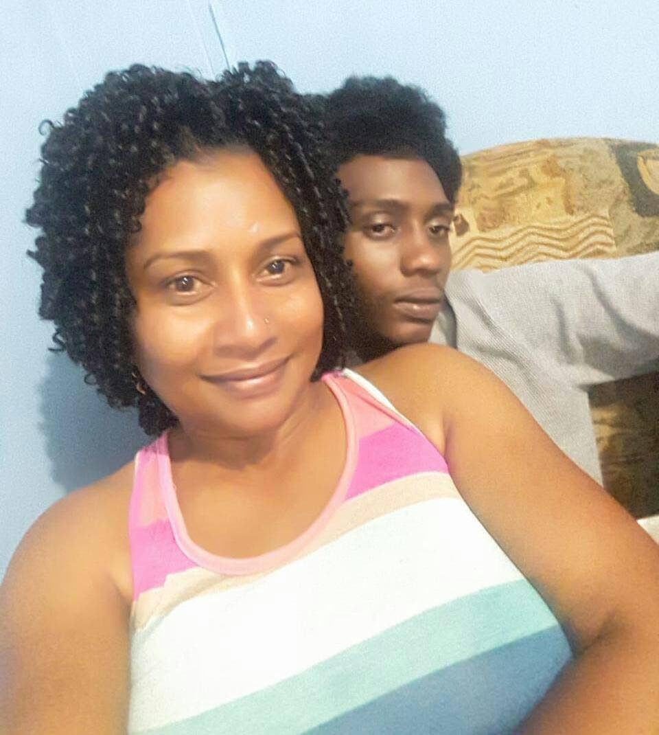 Camille Taitt poses for a selfie with her son Ricardo Dixon who was shot and killed while making his way to work from his home in Carlsen field on Thursday.