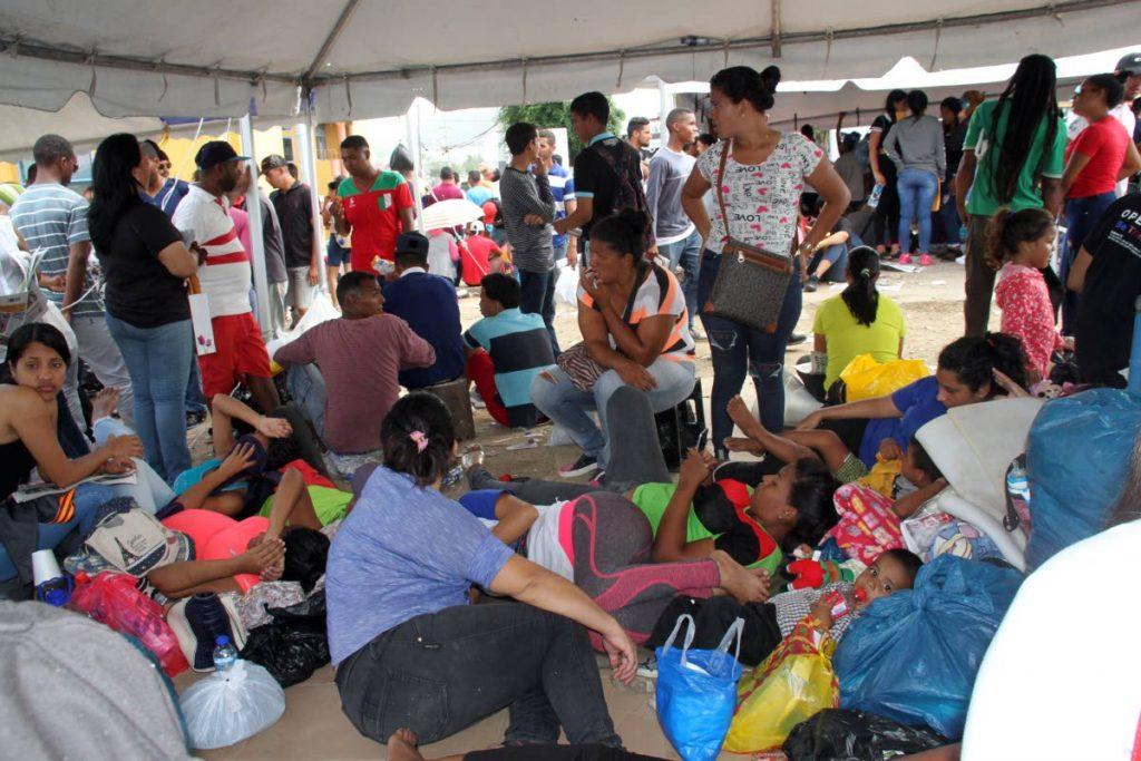 Venezuelan migrants wait to register at Acheivors Banquet Hall, Duncan Village, San Fernando on June 16. PHOTO BY VASHTI SINGH