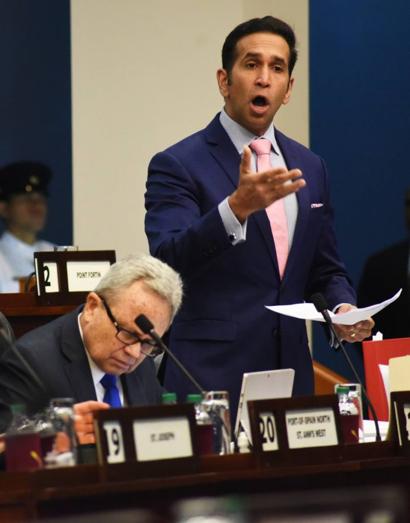 Attorney General Faris Al-Rawi addresses Parliament on the Miscellaneous Provisions (Tax Amnesty, Pensions, Freedom of Information, National Insurance, Central Bank and Non-Profit Organisations) Bill on Friday. PHOTO BY KERWIN PIERRE