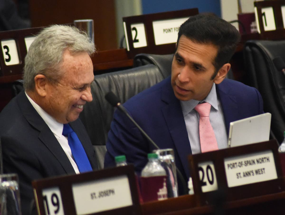 Finance Minister Colm Imbert, left, and Attorney General Faris Al-Rawi during Parliament on Friday. PHOTO BY KERWIN PIERRE