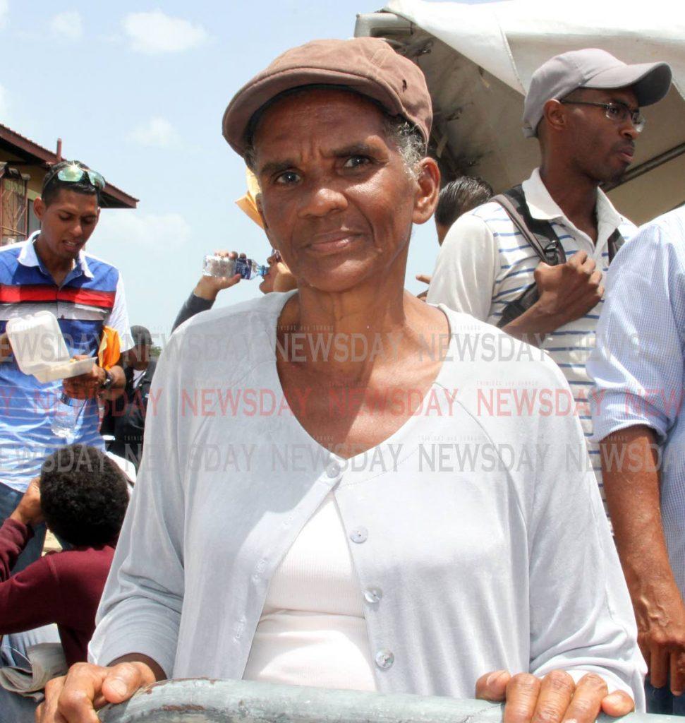 Venezuelan Xuomana Cedeno 63, waiting to register at Achievors Banquet Hall, Duncan Village , San Fernando. Photo by Vashti Singh