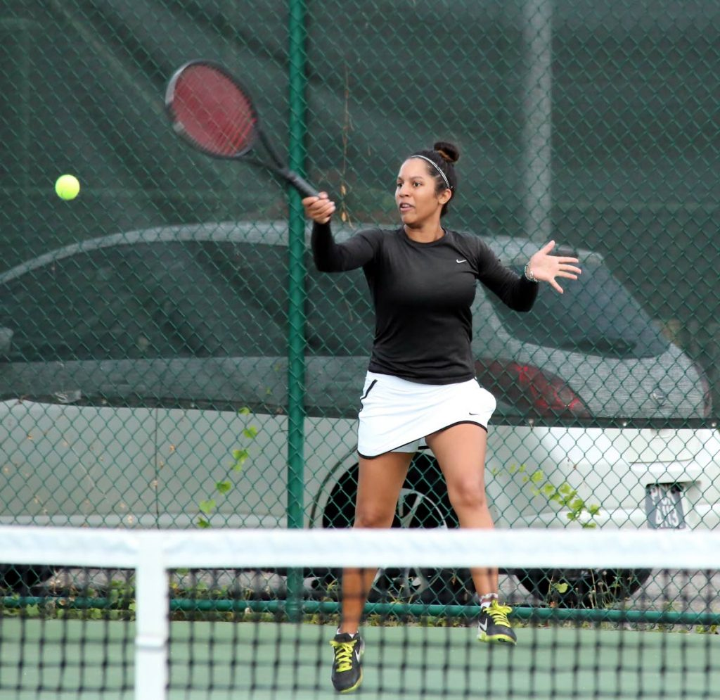 Carlista Mohammed won the singles, women's doubles and mixed doubles titles at the 2019 National Open Tennis Championships. PHOTO BY SUREASH CHOLAI
