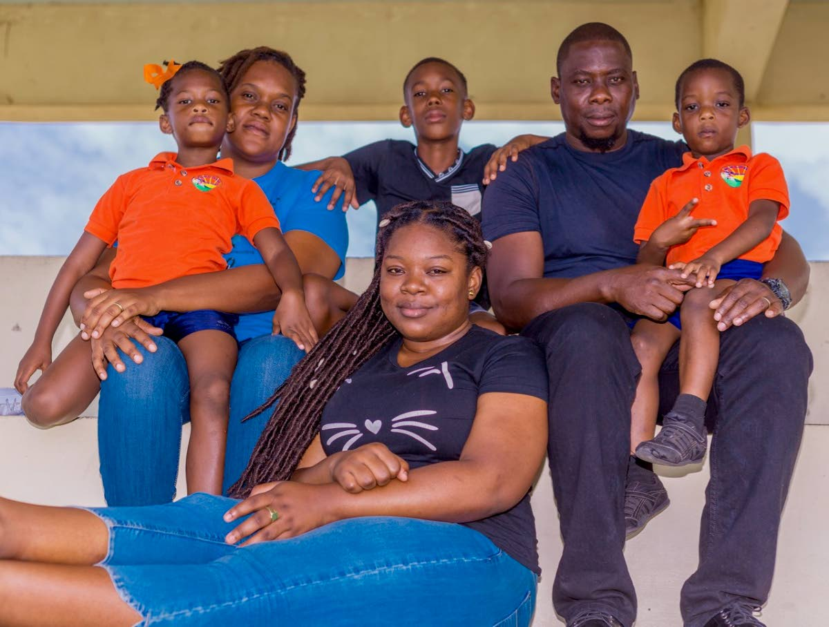 Ryan Stewart with his family, from left, daughter N'Kaylia, wife Sherrena, son Ayden, daughter Camelia, and son Zico at their home in Patience Hill, Tobago. PHOTO BY DAVID REID