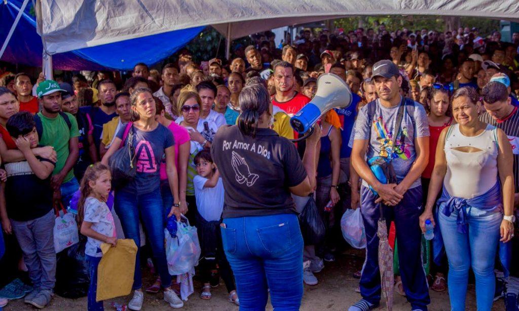 Venezuelans get instructions on the deadline day for registration at Caroline Building in Scarborough last week. PHOTO BY DAVID REID