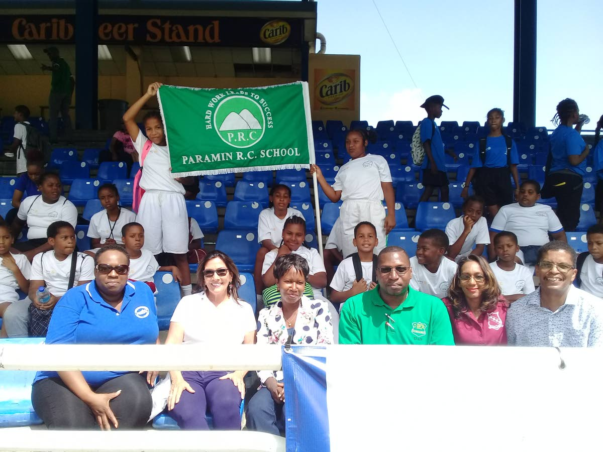Paramin RC students, back, celebrate after winning the tournament. Also in the photo are lady of assumption at Boissiere RC Letticia Noreiga-Phillip, from left sitting, president of the Rotary Club of Maraval Jennifer Abraham, curriculum officer physical education and sport at the Ministry of Education Shelly Slater, La Seiva RC principal Benil Niles, Maraval RC principal Kathleen Merhair-Gransam and Paramin RC principal Camillus Olivier.