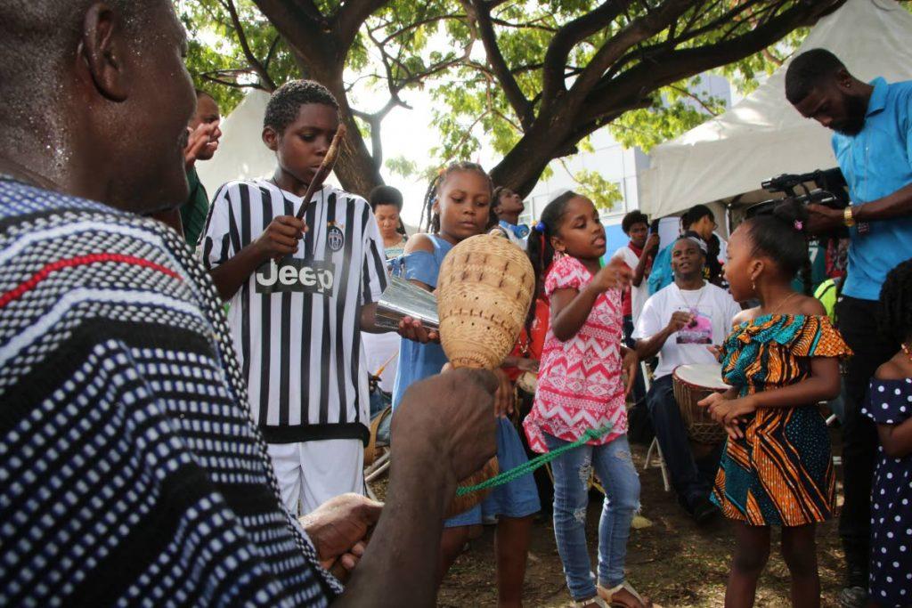 The children show appreciation for the drum festival.