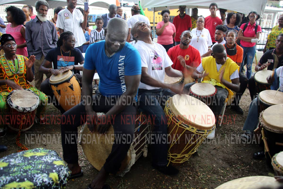 Drummers from different groups perform at the Yoruba Village Drum Festival, Besson Street, Port of Spain yesterday. PHOTO SUREASH CHOLAI