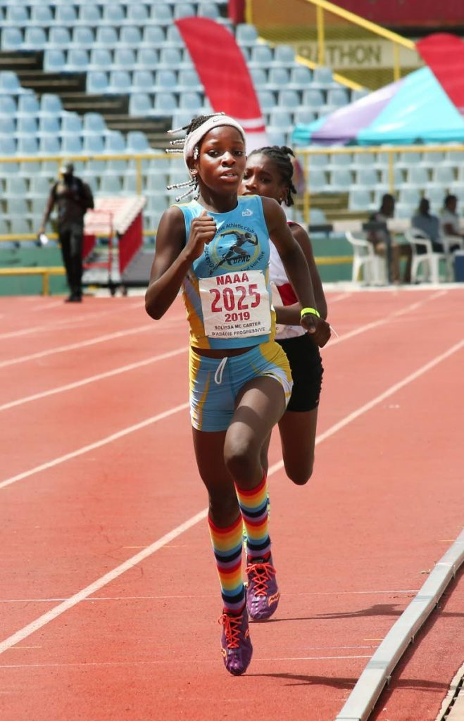 BIG WIN: Solissa McCarter of D'Abadie Progressive Club on her way to victory in the girls 800m final at the NGC/NAAA Juvenile Championsips at Hasely Crawford Stadium, Mucurapo, yesterday. PHOTO BY SUREASH CHOLAI