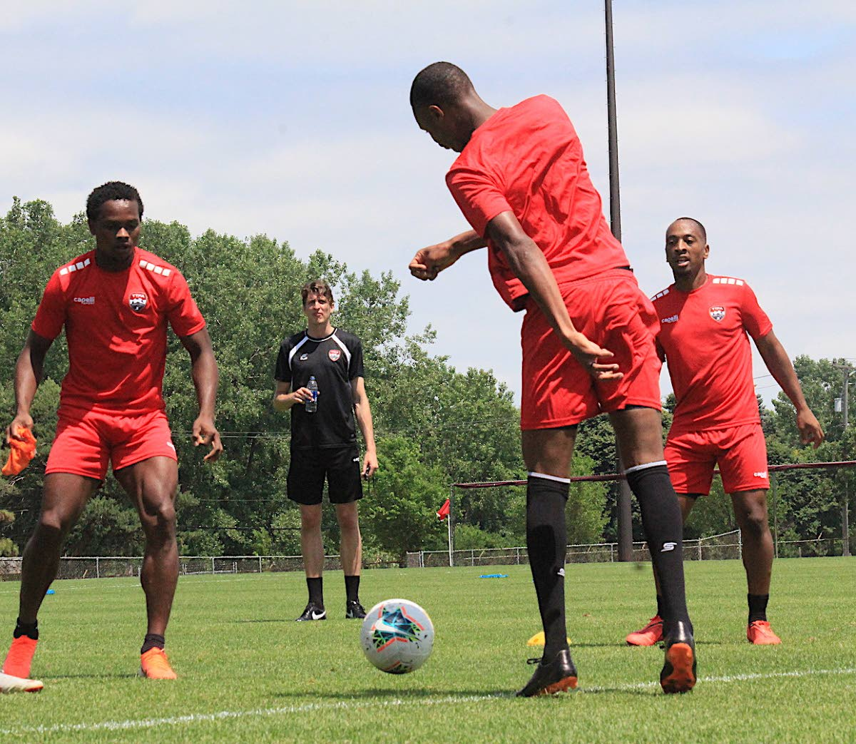 TT's Levi Garcia, left, Kevan George, centre, and Leston Paul, right, take part in a training session ahead of their Gold Cup opener against Panama tomorrow. PHOTO BY TTFA MEDIA