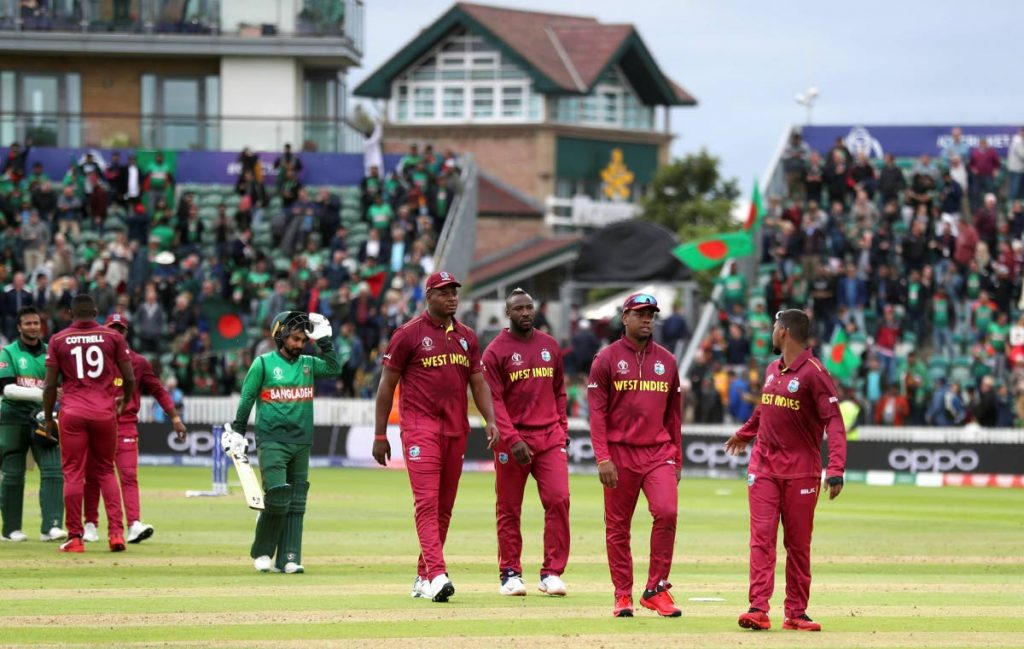 West Indies players walk off dejected after losing the Cricket World Cup match between West Indies and Bangladesh at The Taunton County Ground, Taunton, south west England, on Monday.  AP PHOTO