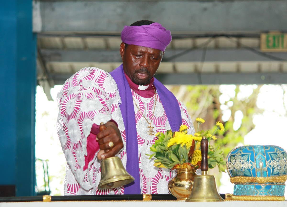 LAST RITES: Bishop Carlisle Blackman officiates at the funeral on Monday for Shouter Baptist Archbishop Ivan Lancaster at Palms Club in San Fernando.