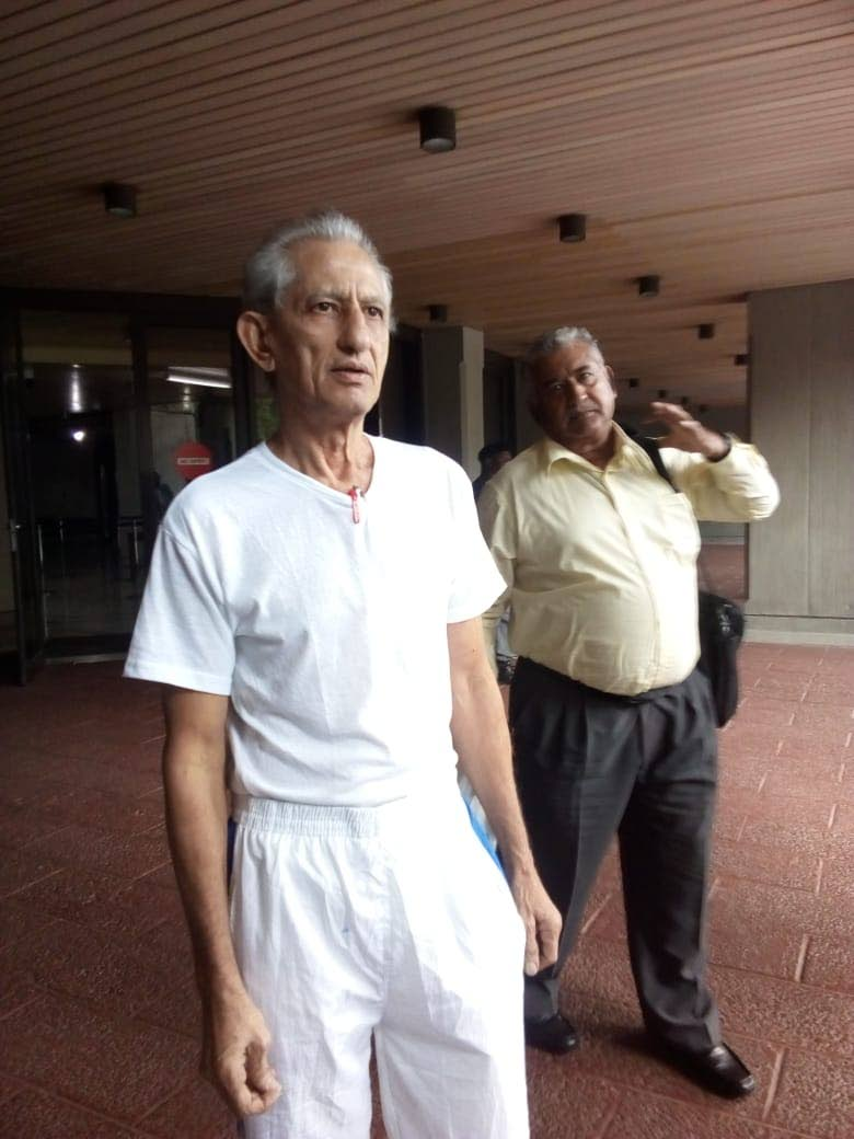 Azaad Ali and his brother Anthony Marciano leave the Hall of Justice in Port of Spain after he was ordered to be released by a High Court judge.