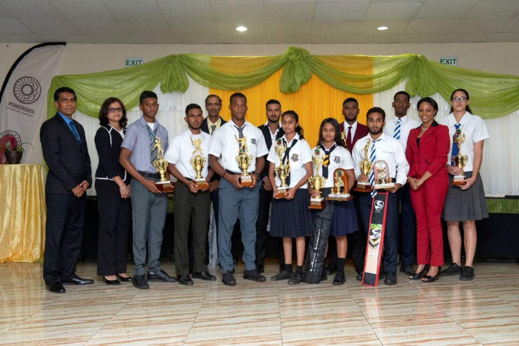 Schools cricketers pose with officials and invited guests at the PowerGen SSCL Awards at the Couva/Point Lisas Chamber of Commerce, yesterday. Krishna Rampersad of PowerGen, from left, Marsha Mohammed of PowerGen, Nicholas Ali, Tariq Mohammed, Surujdath Mahabir of the SSCL, Cephas Cooper, TT Red Force cricketer Amir Jangoo, Genelia Juppy, Suriya Sookoo, Navin Bidaisee, Andre Seetaram, Leon Basanoo, former West Indies Women's cricketer Merissa Aguilleira and Jesse Ferdinand.