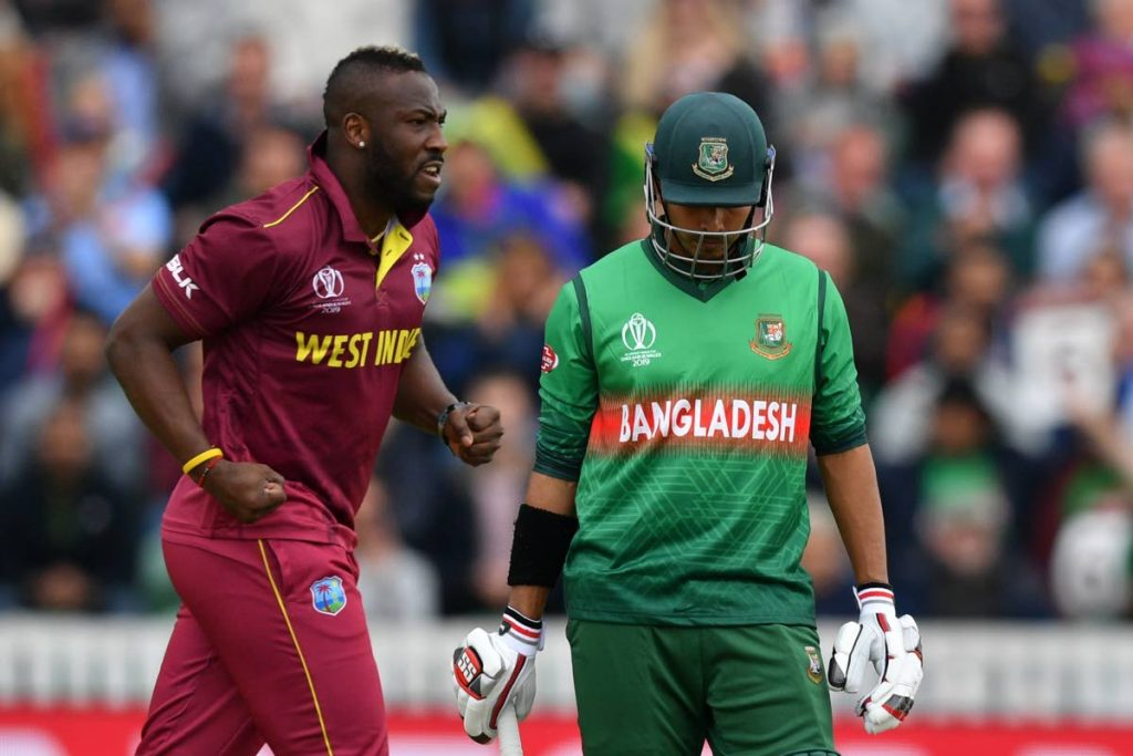 West Indies' Andre Russell, left, has been ruled out the 2019 Cricket World Cup with injury. (AFP)