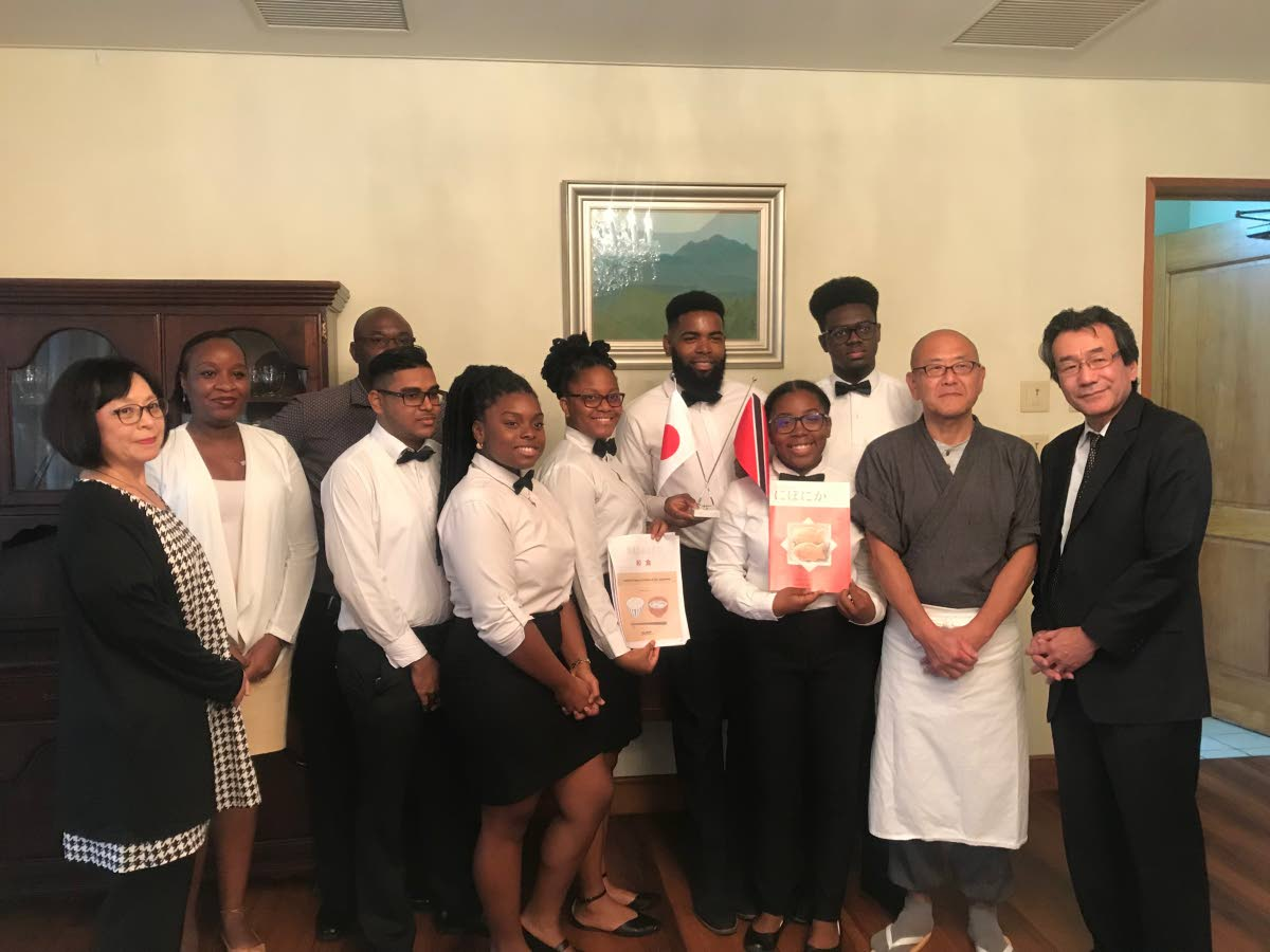Japanese ambassador Tatsuo Hirayama, right, and his wife, Sachiko Hirayama, left, with resident chef Jinich Osawa, second from right, TTHTI students, student coordinator, Renatta Francis, second from right, and TTHTI chef Virges Lovelace, at back.
