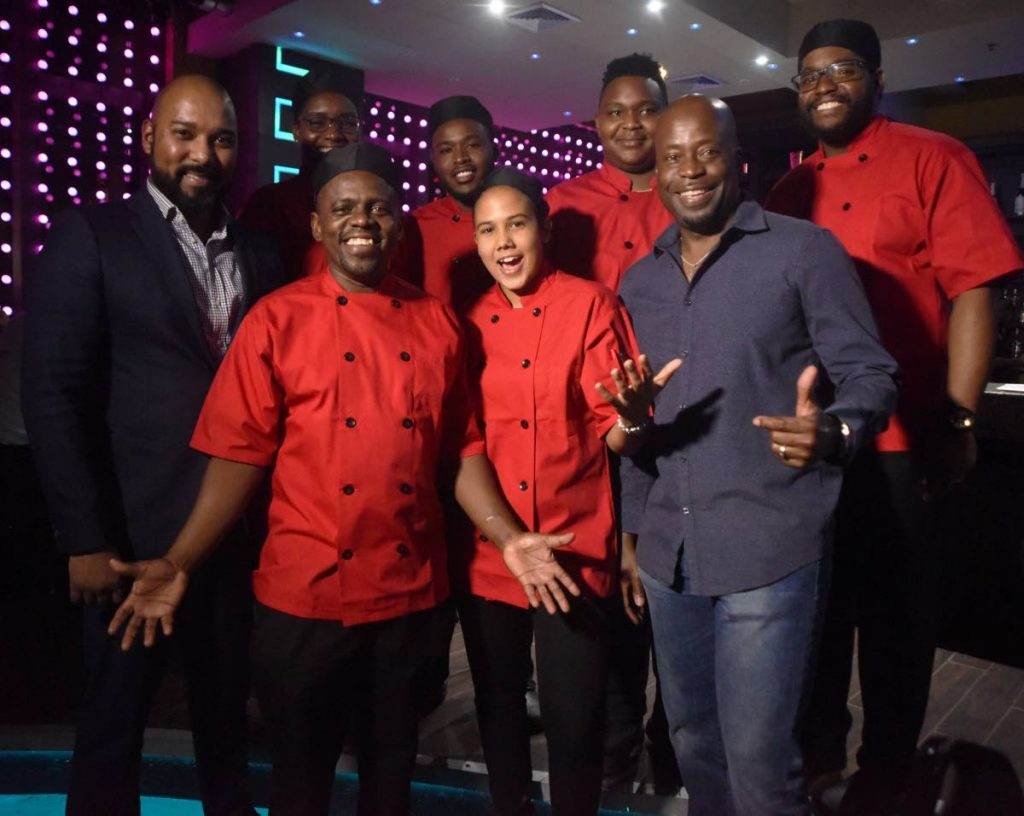 National Culinary Team pose for a pictures with THRTA CEO Brian Frontin left  and of President of THRTA Hassel Thom during Farewell dinner for Culinary Team at the Residence One Woodbrook Place.   PHOTO BY KERWIN PIERRE.