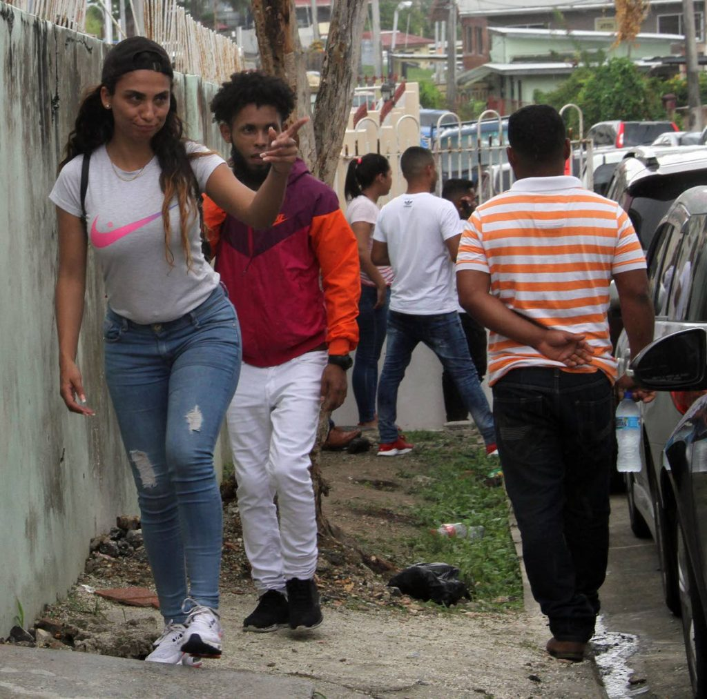 A Venezuelan woman heads along Knox Street, San Fernando near the Immigration Division office on June 18. PHOTO BY VASHTI SINGH