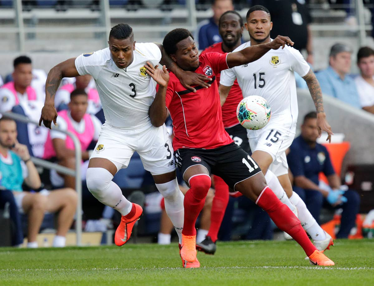 Trinidad and Tobago's Levi Garcia (#11) battles for the ball with Panama's Harold Cummings during the first half of a CONCACAF Gold Cup game on Tuesday in St Paul, Minnesota. (AP PHOTO)