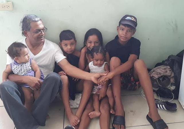 Dr Rampersad Lutchman with Venezuelan migrant children. The three older ones are the children of Evelyn Mata Rojas who was killed on June 7.
